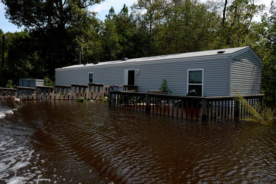 A flooded FEMA trailer in Deweyville on Monday. Many residents who lost their homes in the 2016 flood have now been damaged by Harvey's flooding.  Photo taken Monday 9/4/17 Ryan Pelham/The Enterprise Photo: Ryan Pelham / ©2017 The Beaumont Enterprise/Ryan Pelham