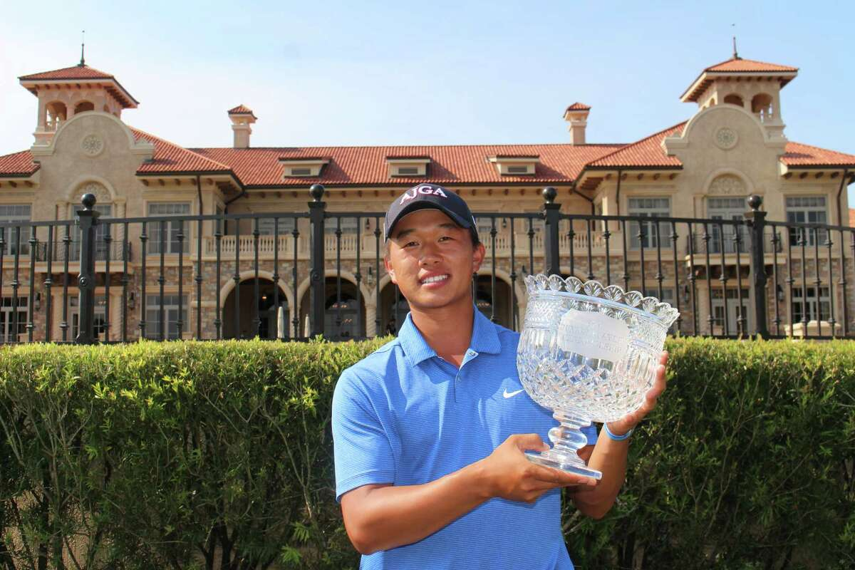The John Cooper School senior Ben Wong displays his trophy after winning The Junior PLAYERS Championship on Sunday.