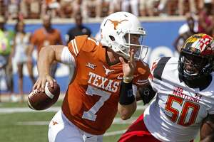 Texas quarterback Shane Buechele (7) runs the ball against Maryland linebacker Mbi Tanyi (50) during the first half of an NCAA college football game, Saturday, Sept. 2, 2017, in Austin, Texas. (AP Photo/Michael Thomas)