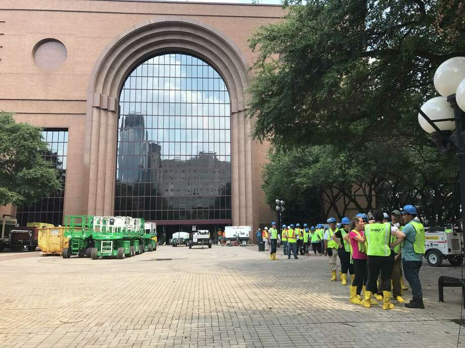 Remediation crews and equipment outside the Wortham Theater Center on Monday, Sept. 4, 2017, preparing to remove silt from city-owned facilities that flooded during Hurricane Ike. Flood water was still being pumped from the bottom two floors of the Theater District parking garage and some of the Wortham basement were still being pumped. Gilbane is managing the remediation for Houston First, which operates the city-owned facilities. Photo: Molly Glentzer