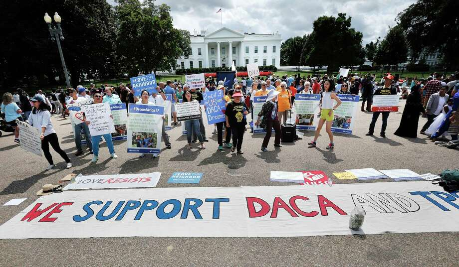 In this Sunday, Sept. 3, 2017 photo, supporters of Deferred Action for Childhood Arrivals program (DACA), demonstrate on Pennsylvania Avenue in front of the White House in Washington. President Donald Trump is expected to announce that he will end protections for young immigrants who were brought into the country illegally as children, but with a six-month delay, people familiar with the plans said. (AP Photo/Pablo Martinez Monsivais) Photo: Pablo Martinez Monsivais, STF / Copyright 2017 The Associated Press. All rights reserved.