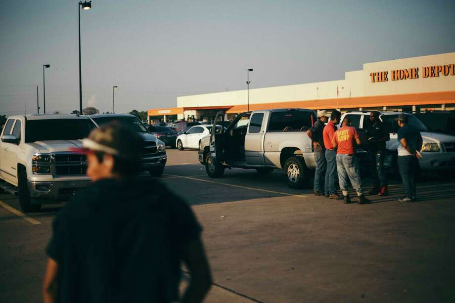 Day laborers seek work in a Home Depot parking lot in southwestern Houston on Saturday as the region starts to recovery from Hurricane Harvey. Photo: Photo For The Washington Post By John Taggart / The Washington Post