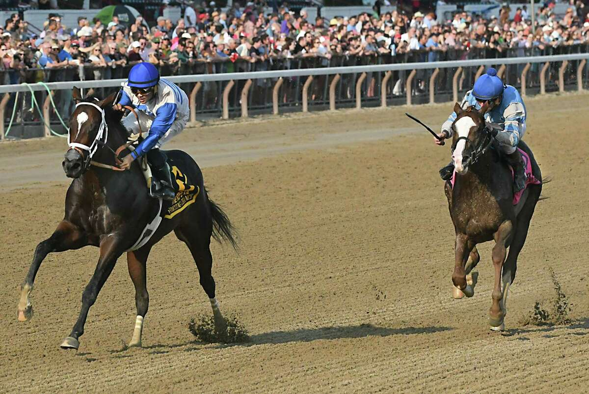 Jockey Luis Saez, riding Sporting Chance, left, manages not to fall off as he drifts in front of Free Drop Billy ridden by Robby Albarado, right, in the final stretch during The Hopeful, the last feature race of the season at Saratoga Race Course on Monday, Sept. 4, 2017 in Saratoga Springs, N.Y. Sporting Chance won the race. (Lori Van Buren / Times Union)