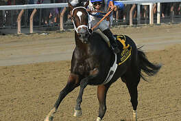 Jockey Luis Saez, riding Sporting Chance manages not to fall off as he drifts in front of Free Drop Billy ridden by Robby Albarado, not in photo, during The Hopeful, the last feature race of the season at Saratoga Race Course on Monday, Sept. 4, 2017 in Saratoga Springs, N.Y. Sporting Chance won the race. (Lori Van Buren / Times Union)