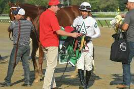 Jockey Jose Ortiz dismounts the horse National Flag after competing in The Hopeful, the last feature race of the season at Saratoga Race Course on Monday, Sept. 4, 2017 in Saratoga Springs, N.Y. Sporting Chance won the race. (Lori Van Buren / Times Union)