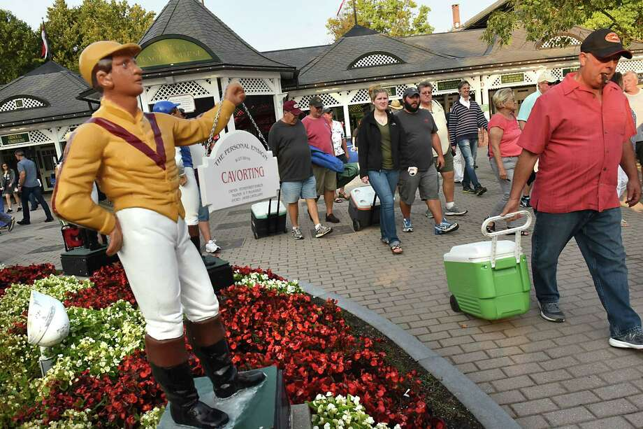 Racetrack patrons leave after the last race of the season at Saratoga Race Course on Monday, Sept. 4, 2017 in Saratoga Springs, N.Y. (Lori Van Buren / Times Union) Photo: Lori Van Buren / 20041441A