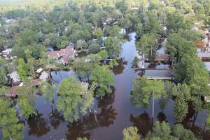 Despite a mandatory evacuation order because of Tropical Storm Harvey, Jefferson County Sheriff's Deputy Marcus McLellan said residents had begun returning to Bevil Oaks to rescue pets. They may face criminal charges.