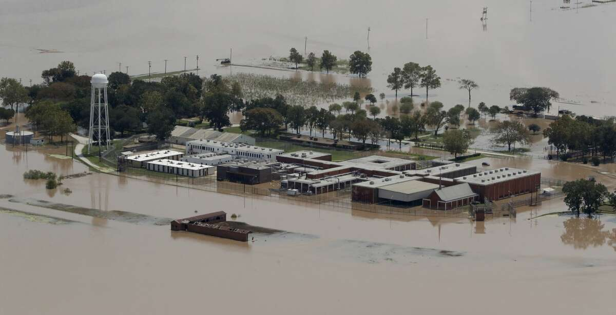 A Texas State prison unit is submerged by water from the flooded Brazos River in the aftermath of Hurricane Harvey Friday, Sept. 1, 2017, in Rosharon, Texas (AP Photo/Charlie Riedel)