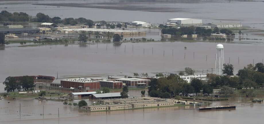 A Texas State prison unit is submerged by water from the flooded Brazos River in the aftermath of Hurricane Harvey Friday, Sept. 1, 2017, in Rosharon, Texas (AP Photo/Charlie Riedel) Photo: Charlie Riedel/Associated Press
