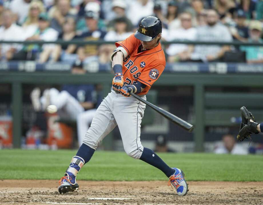 SEATTLE, WA - SEPTEMBER 4: Josh Reddick #22 of the Houston Astros hits a two-run sinlge off of relief pitcher Nick Vincent #50 of the Seattle Mariners that scored Alex Bregman #2 of the Houston Astros and George Springer #4 of the Houston Astros during the seventh inning of a game at Safeco Field on September 4, 2017 in Seattle, Washington. Photo: Stephen Brashear, Getty Images / 2017 Getty Images
