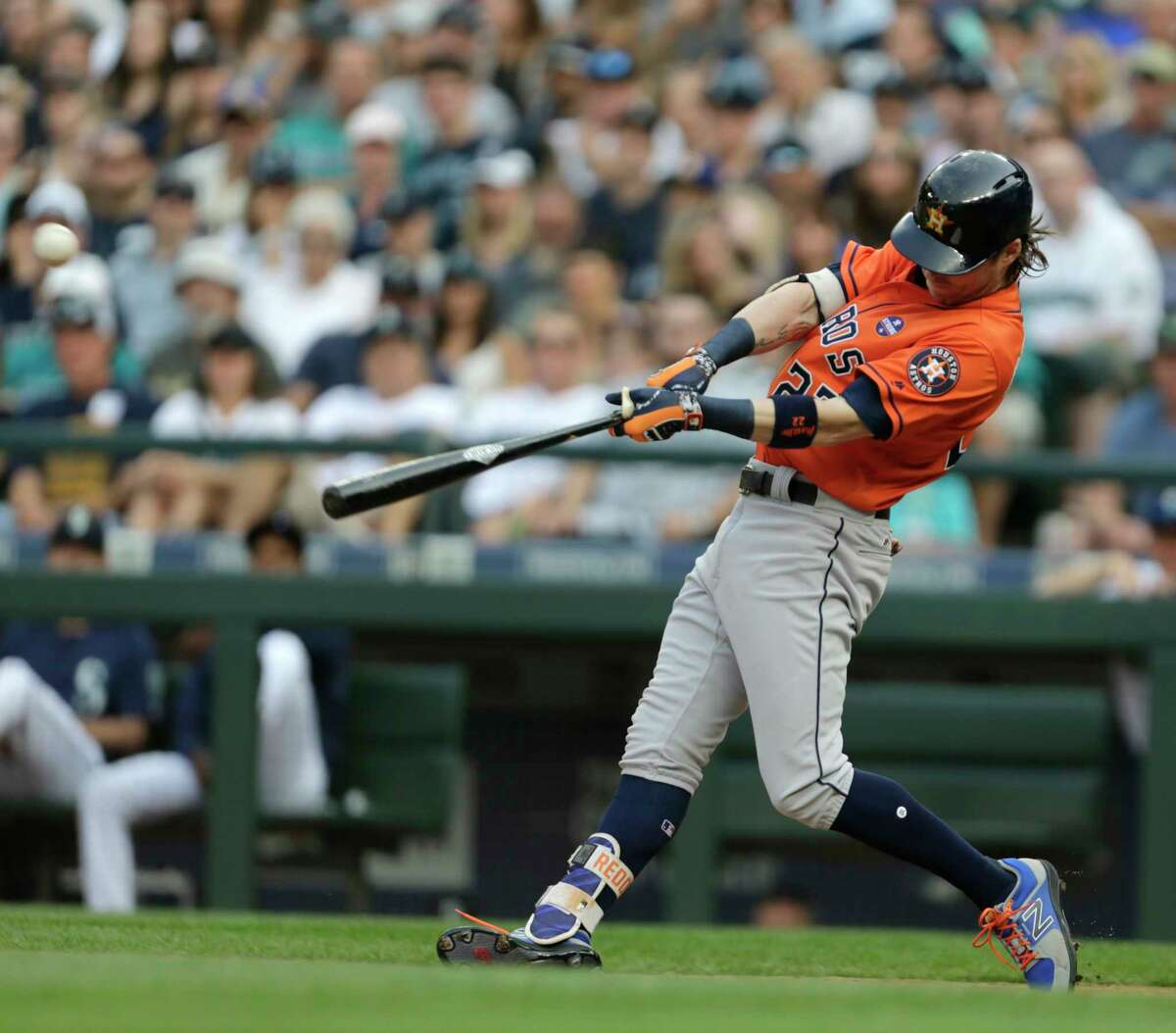 Houston Astros' Josh Reddick hits a two-run single against the Seattle Mariners during the seventh inning of a baseball game, Monday, Sept. 4, 2017, in Seattle. (AP Photo/John Froschauer)