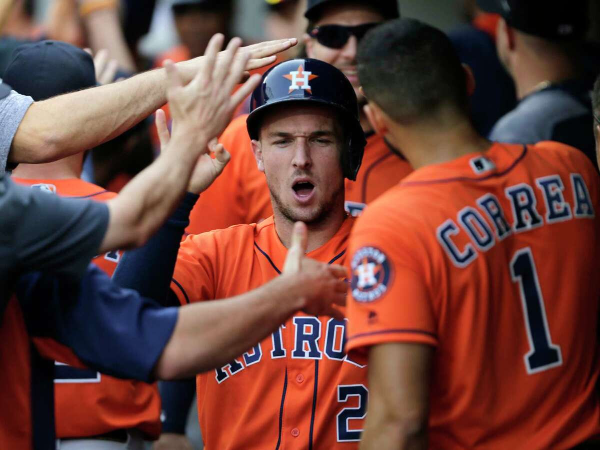 Houston Astros' Alex Bregman celebrates in the dugout after scoring on a double hit by Josh Reddick against the Seattle Mariners during the seventh inning of a baseball game, Monday, Sept. 4, 2017, in Seattle. He also hit a two-run double in the inning (AP Photo/John Froschauer)