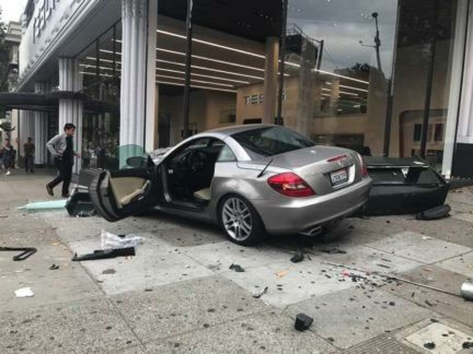 A Mercedes crashed into a Tesla dealership in San Francisco Monday afternoon, officials said. Photo: SFGATE / /SFGATE