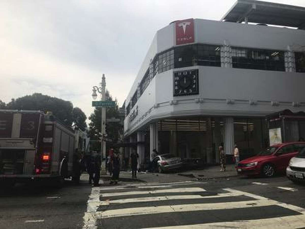 The scene on Van Ness Avenue after a Mercedes reportedly crashed into a Tesla dealership Monday afternoon.