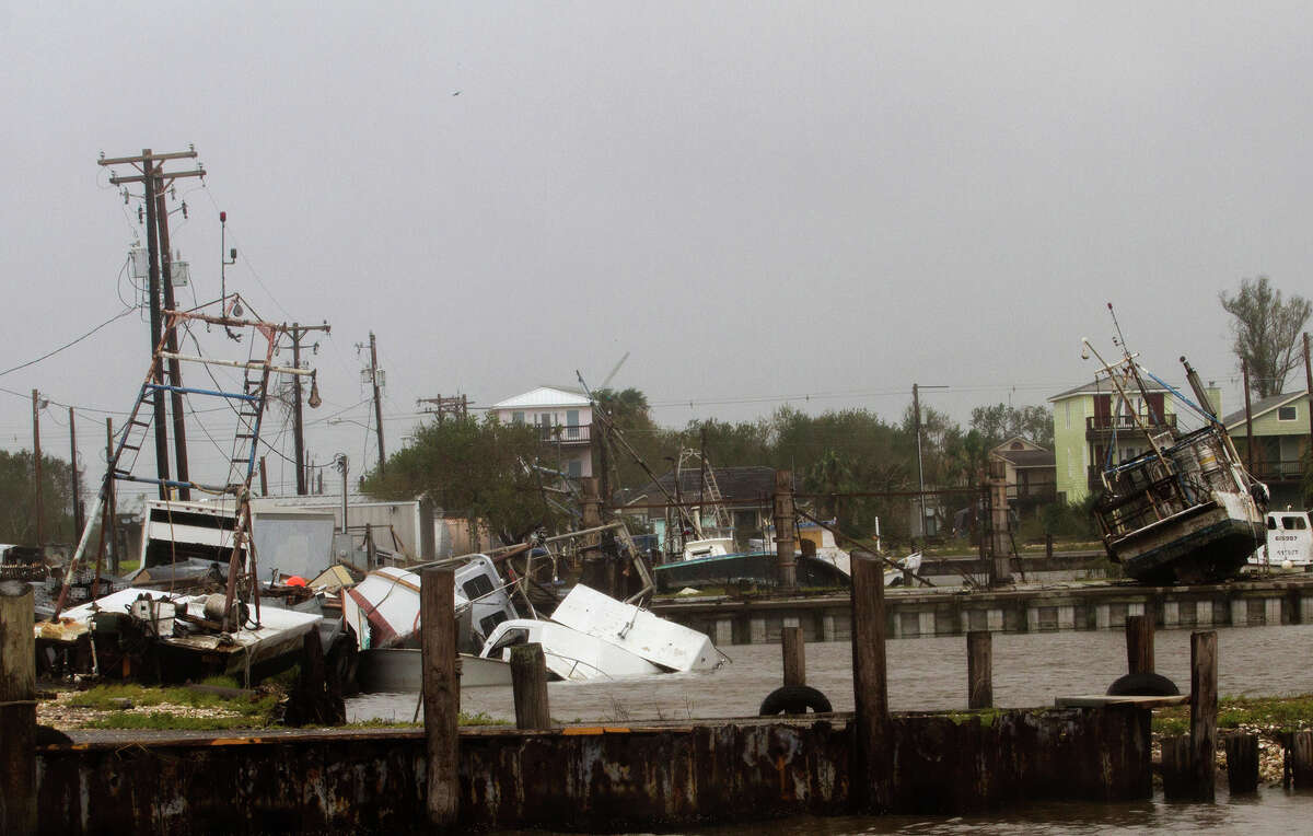 In this Aug. 26, 2017 photo, shrimp and oyster boats are strewn about in the Seadrift, Texas docks after Hurricane Harvey hit the area.