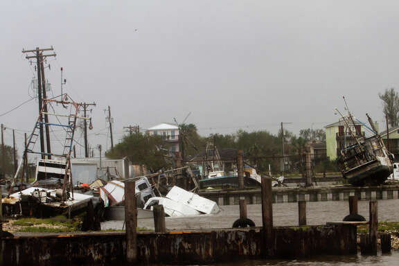 In this Aug. 26, 2017 photo, shrimp and oyster boats are strewn about in the Seadrift, Texas docks after Hurricane Harvey hit the area. (Nicolas Galindo/The Victoria Advocate via AP)