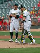 A's starting pitcher Chris Smith and catcher Bruce Maxwell talk things over after a solo  home run in the third inning by the Angels' Martin Maldonado to tie the game at 4-4 as the Oakland Athletics take on the Los Angeles Angels at the Oakland Coliseum in Oakland, Ca. on Mon. September 4, 2017.