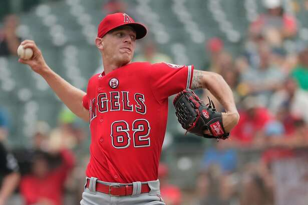 Angels'starting pitcehr Parker Bridwell throws as the Oakland Athletics take on the Los Angeles Angels at the Oakland Coliseum in Oakland, Ca. on Mon. September 4, 2017.