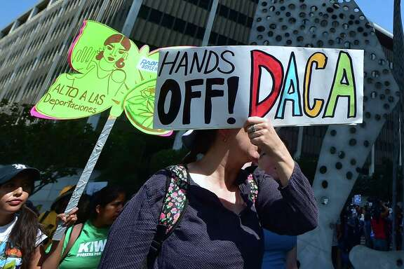 Young immigrants and supporters rally Friday in support of the Deferred Action for Childhood Arrivals program in Los Angeles. President Donald Trump is expected to decide Tuesday whether to end the program.
