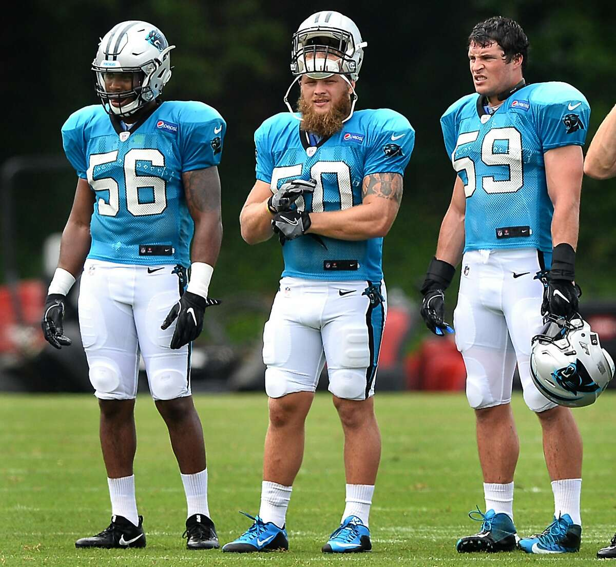 Carolina Panthers linebackers Zeke Bigger, left, Ben Boulware, center and Luke Kuechly, right, watch the team run through drills during practice on Friday, July 28, 2017 at Wofford College in Spartanburg, S.C. (Jeff Siner/Charlotte Observer/TNS)