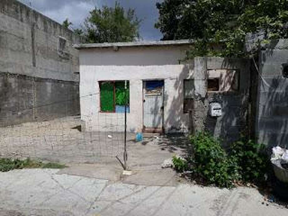Tamaulipas authorities said this home in Nuevo Laredo, Mexico, is where a couple held 11 immigrants against their will. Photo: Courtesy Photo /