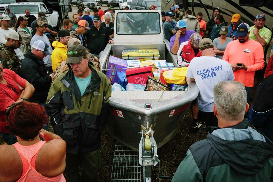 Cajun Navy volunteers hash out their final destination as they stopped on Interstate 10 while traveling from Louisiana to Houston, Monday, Aug. 28. Photo: EDMUND D. FOUNTAIN, NYT / NYTNS