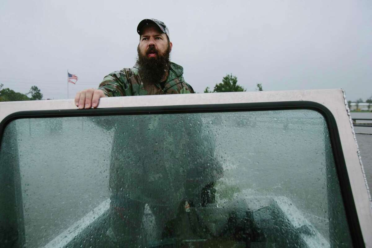 Ben Theriot, of Prarieville, La., a Cajun Navy volunteer,searches for evacuees in Humble, Tues., Aug. 29.