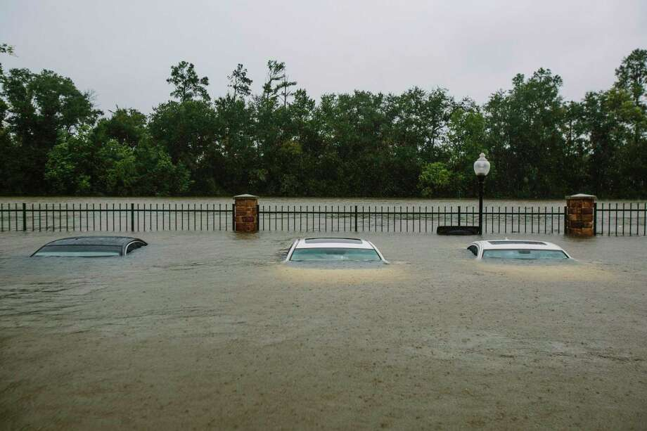 Flooded cars in a Humble apartment complex parking lot visited by volunteer rescuers with the Cajun Navy, Tue., Aug. 29. Photo: EDMUND D. FOUNTAIN, NYT / NYTNS