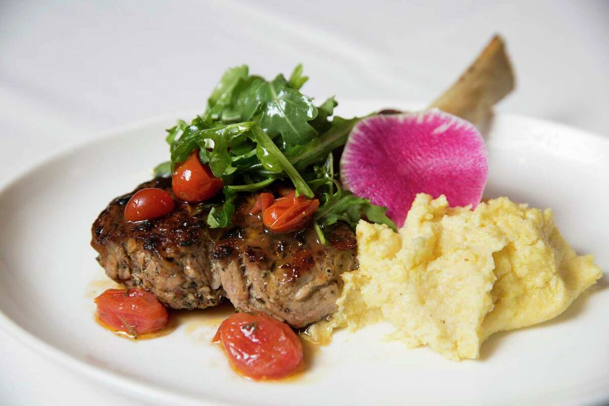 Veal chop with thyme roasted tomatoes and arugula at Da Marco