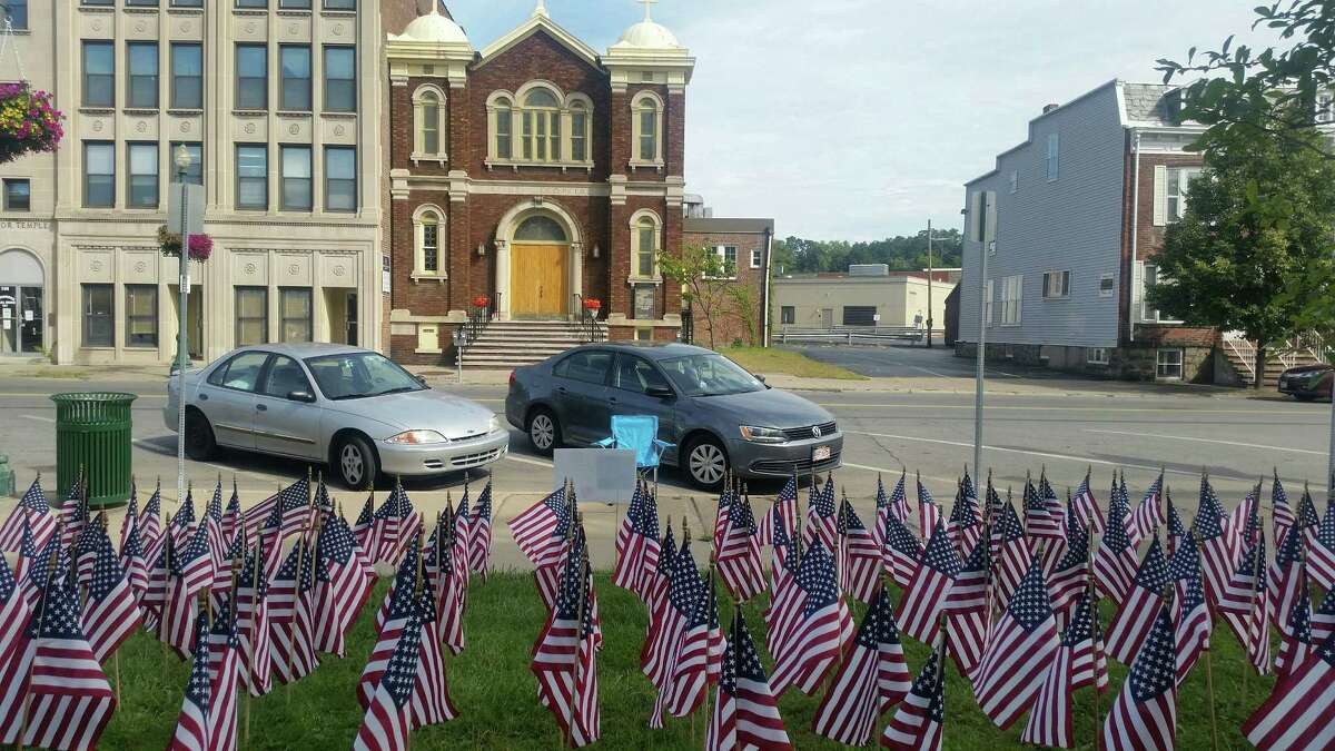 Schenectady resident Jean Kirschenheiter placed 660 flags outside Schenectady City Hall the week of Aug. 28, 2017, to raise awareness about PTSD and military suicide in honor of her son Raymond, who took his own life in 2016. (Lynda J. Edwards/Times Union)