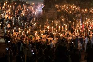 "Chanting ""white lives matter!"" and ""Jews will not replace us!"" hundreds of neo-Nazis and white supremacists carried torches across the University of Virginia campus Aug. 11. Is Donald Trump a white supremacist? While his statements sometimes fit the label, the real source of his superiority is his narcissism and wealth not the color of his skin."