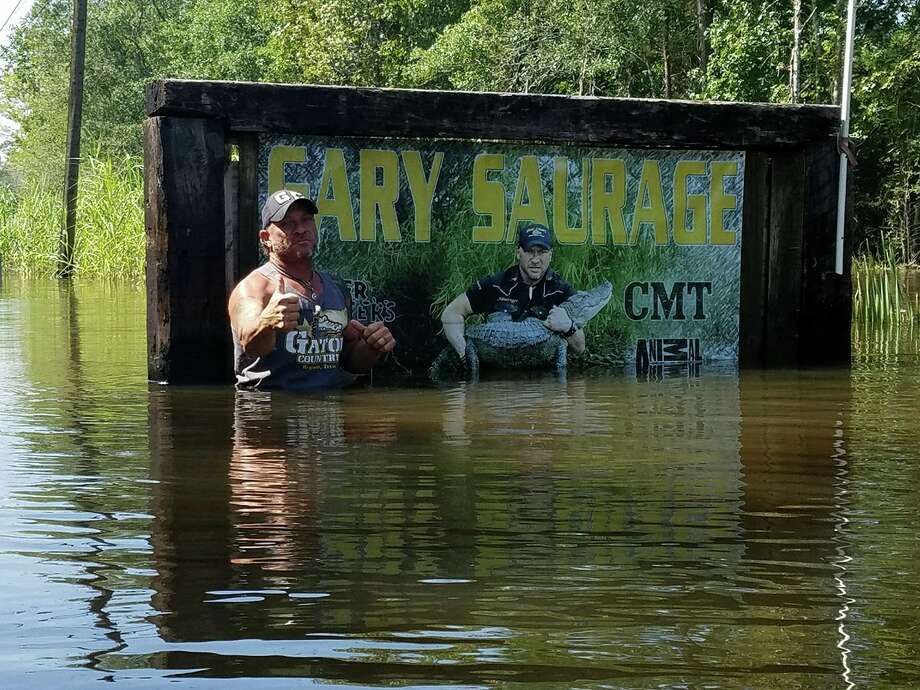 Gator Country owner Gary Saurage shows how high Harvey flood waters reached inside the animal park.