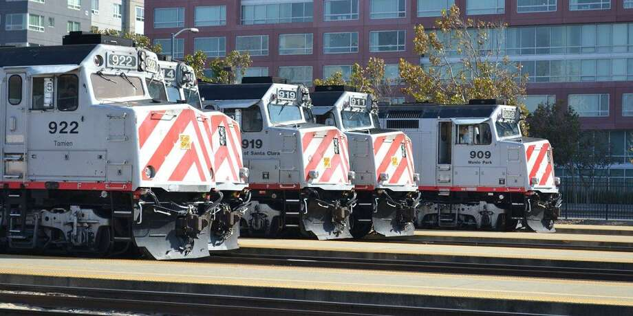 A man whose car crashed onto Caltrain tracks died when a train struck him Tuesday, authorities said.