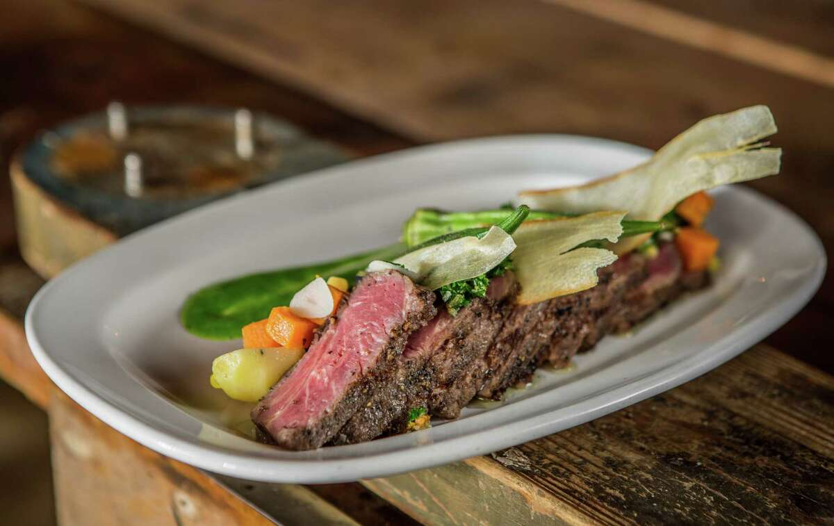 South American flat iron steak with Peruvian potato, grilled okra and chimichurri sauce at Brasserie 1895