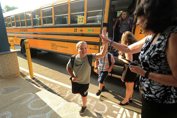 Students arrive for the first day of school at Mohegan School in Shelton, Conn. on Tuesday, September 5, 2017.