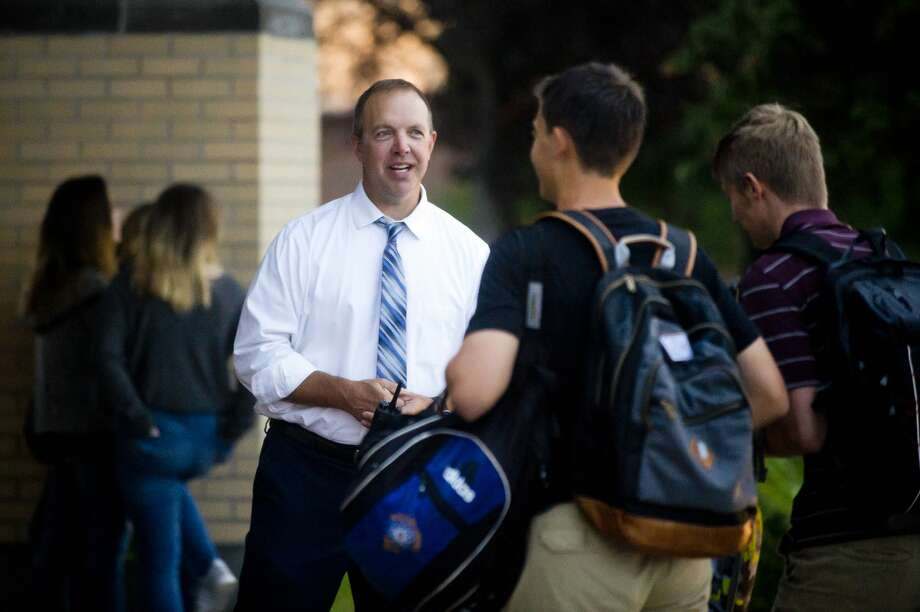 FILE — Midland High School Principal Jeff Jaster greets students as they enter Midland High for the first day of school on Tuesday morning, September 5, 2017. Photo: (Katy Kildee/kkildee@mdn.net)