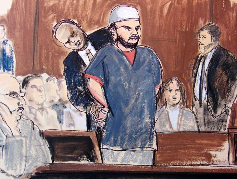 ** CORRECTS TO SAY U.S. MARSHALL REMOVES HANDCUFFS ** In this courtroom sketch, a U.S. Marshall removes Faisal Shahzad's handcuffs in the courtroom Monday, June 21, 2010, in New York. Shahzad, who appeared in federal court on an indictment accusing him of plotting a failed Times Square car bombing, was told by a judge that his hearing is being postponed until later Monday afternoon. He's accused in a plot that fizzled when a gasoline-and-propane bomb failed to ignite in a sport utility vehicle parked near a Broadway theater May 1. (AP Photo/Elizabeth Williams) Photo: AP