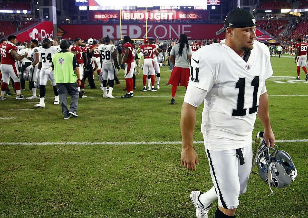 Oakland Raiders kicker Sebastian Janikowski (11) leaves the field after an NFL preseason football game against the Arizona Cardinals, Saturday, Aug. 12, 2017, in Glendale, Ariz. The Cardinals won 20-10. (AP Photo/Ross D. Franklin)