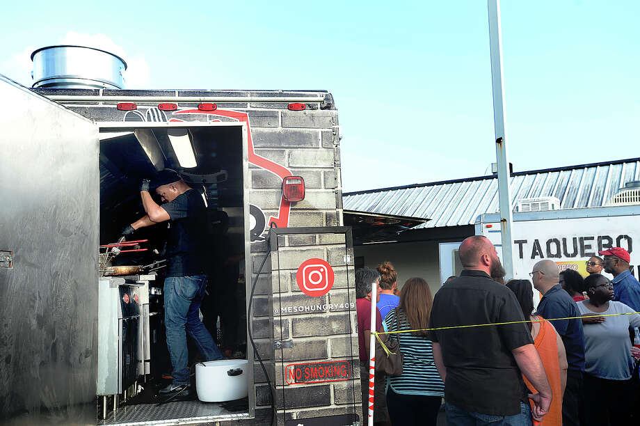 """during """"Food Trucks Invade"""" held at the Logon Cafe Friday. Organized by Dat Mac, the event featured offerings from several local mobile restaurants, each of whom had reasonably priced fare, allowing diners to sample the variety of dishes available. Inside the cafe, local musicians Ryan Gist and Trevor Batson performed. Photo taken Friday, June 30, 2017 Kim Brent/The Enterprise Photo: Kim Brent / BEN"""