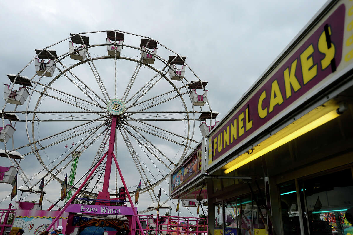 A funnel cake stand at the base of the ferris wheel at the 47th Annual Groves Pecan Festival on Saturday. Photo taken Saturday 11/5/16 Ryan Pelham/The Enterprise