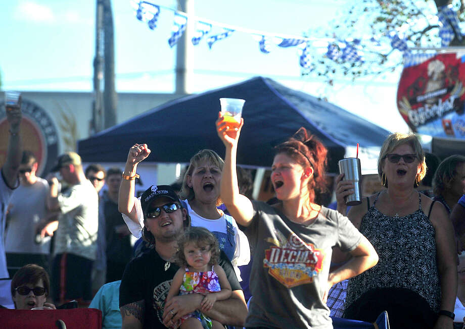Families and friends fill Rogers Park as they enjoy Beaumont's second annual Oktoberfest event held Saturday. Musical entertainment, including a polka performance by The Royal Klobasneks, food trucks, and a beer garden featuring regional craft beers rounded out the main events.  Photo taken Saturday, October 15, 2016 Kim Brent/The Enterprise Photo: Kim Brent / Beaumont Enterprise