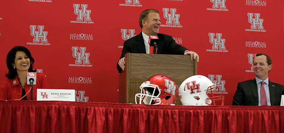 University of Houston Board of Regent Chairman Tillman Fertitta center, speaks as U of H President Renu Khator left, and Major Applewhite right, look on during a press conference announcing Applewhite as the next University of Houston football head coach at TDECU Stadium Dec. 12, 2016, in Houston. ( James Nielsen / Houston Chronicle ) Photo: James Nielsen, Staff / © 2016  Houston Chronicle