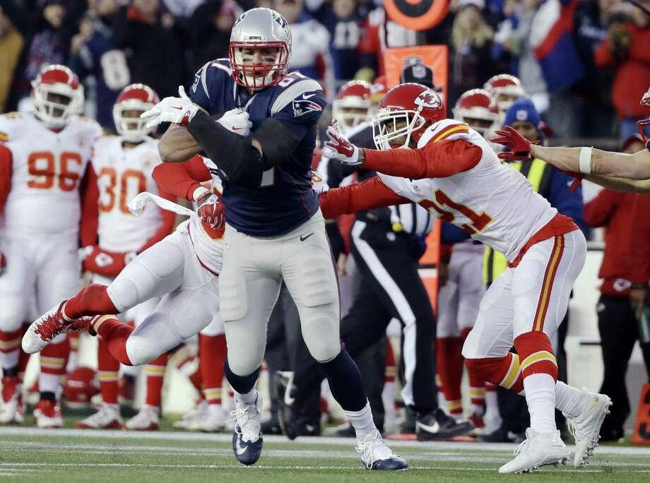 44f2a8adb22 New England Patriots tight end Rob Gronkowski (87) runs from Kansas City  Chiefs cornerback