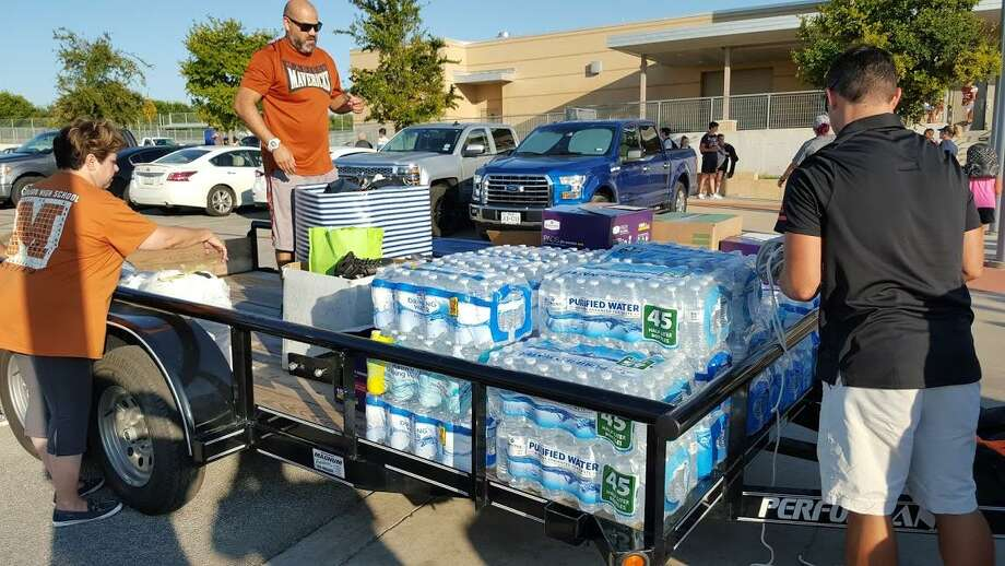 Members of the Madison Athletic Booster Club load bottled water and other supplies to donate to the Hurricane Harvey relief effort for those impacted in Refugio. All the supplies were dropped off at Refugio High School. Photo: Courtesy Photo /Madison Athletic Booster Club