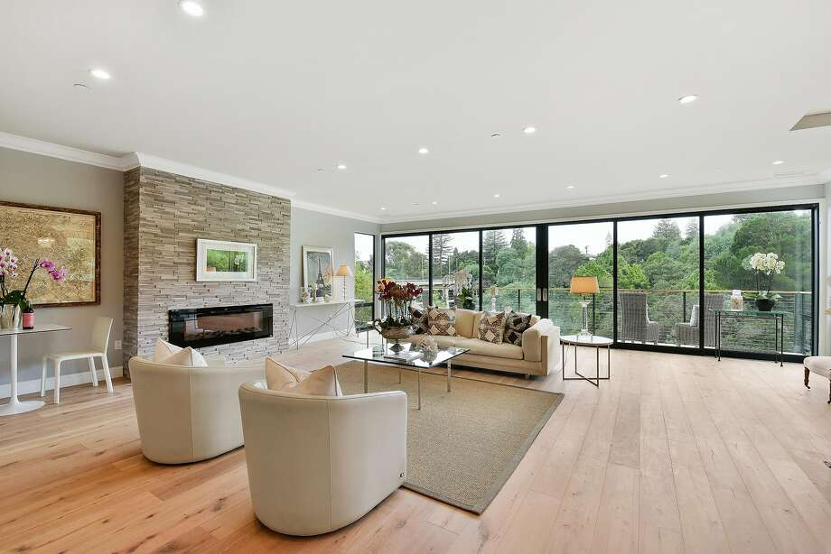 Sliding glass doors in the great room at 4353 Arden Place in Oakland open to a deck with views of the Leimert Bridge and Sausal Creek Park. Photo: Open Homes Photography