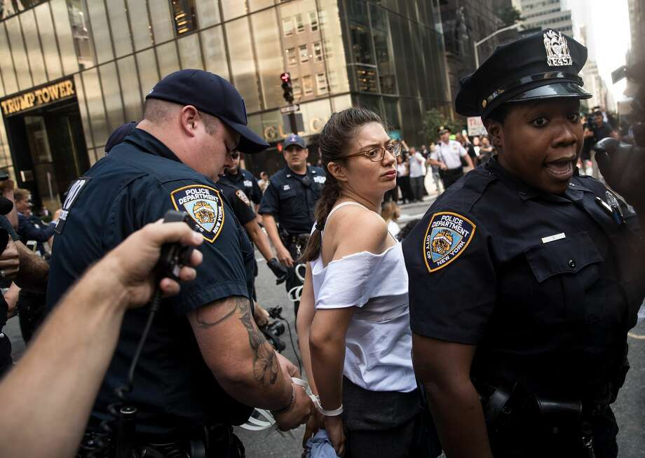Immigration activists protesting the Trump administration's decision on the Deferred Action for Childhood Arrivals are arrested by New York City Police (NYPD) officers after they sat in the street and blocked traffic on 5th Avenue near Trump Tower, September 5, 2017. On Tuesday, the Trump administration announced they will end the Deferred Action for Childhood Arrivals program, with a six month delay. The decision represents a blow to young undocumented immigrants (also known as 'dreamers') who were shielded from deportation under DACA. Photo: Drew Angerer/Getty Images