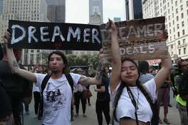 """Dreamer"" Gloria Mendoza, 26, (R) wipes back tears after learning of the Trump Administration decision to end the DACA program while at a protest near Trump Tower on September 5, 2017 in New York City, United States. Both Mendoza and fellow Dreamer Jovan Rodrigo, (L), said they were each brought to the United States from Mexico by their parents when they were children. The Trump administration announced it is ending the Obama-era DACA program that shields young undocumented immigrants from deportation. Up to 800,000 of them brought to the U.S. illegally as children will face possible deportation when the Deferred Action for Childhood Arrivals (DACA) program is set to expire on March 5, 2018."