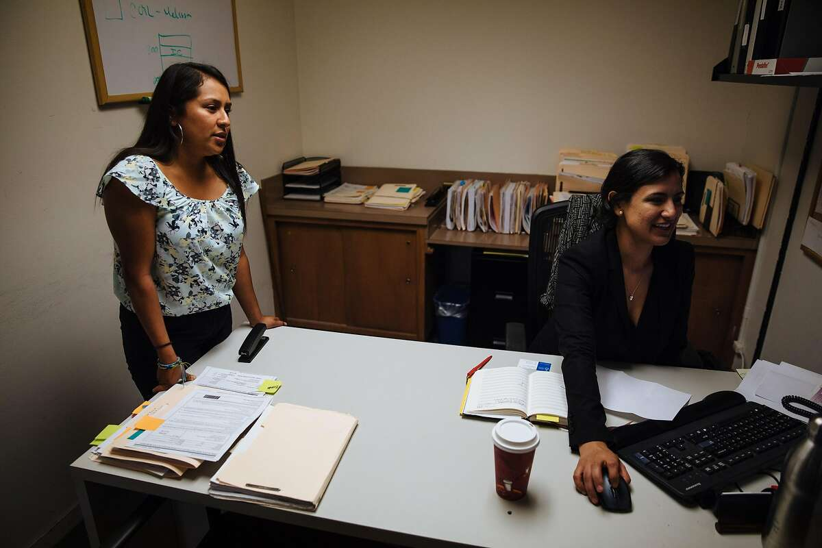 Joseline Gonzalez talks with her friend and colleague, Brenda Olivas, about DACA recipients at Catholic Charities of the East Bay in Oakland, Calif. Thursday, August 31, 2017.