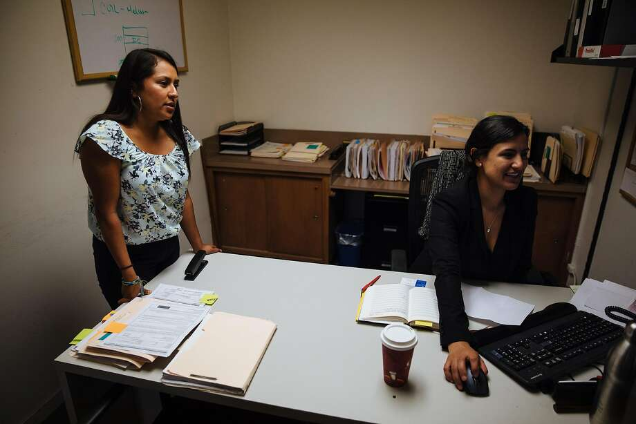 Joseline Gonzalez talks with her friend and colleague, Brenda Olivas, about DACA recipients at Catholic Charities of the East Bay in Oakland, Calif. Thursday, August 31, 2017. Photo: Mason Trinca, Special To The Chronicle