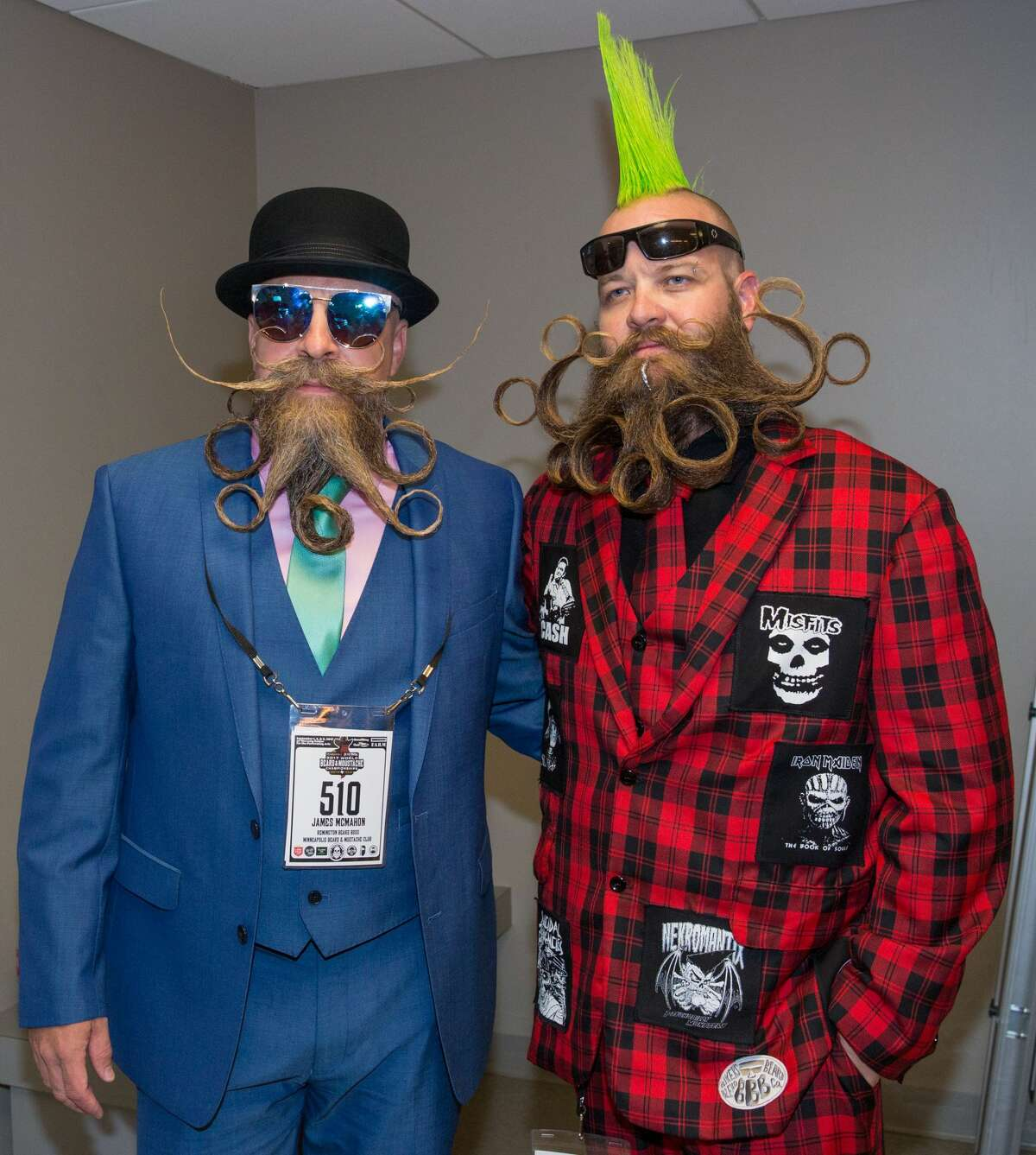 Competitors James McMahon (L) and John Banks attend the 2017 Remington Beard Boss World Beard & Moustache Championships held at the Long Center for the Performing Arts on September 3, 2017 in Austin, Texas. / AFP PHOTO / SUZANNE CORDEIRO (Photo credit should read SUZANNE CORDEIRO/AFP/Getty Images)